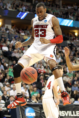 DENVER, CO - MARCH 17:  Terrence Jennings #23 of the Louisville Cardinals dunks the ball late in the against the Morehead State Eagles during the second round of the 2011 NCAA men's basketball tournament at Pepsi Center on March 17, 2011 in Denver, Colora