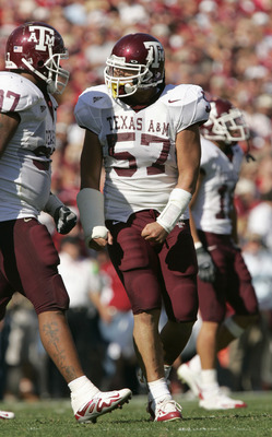 NORMAN, OK - NOVEMBER 12: Lee Foliaki #57 of the Texas A&M Aggies walks on the field during the game against the Oklahoma Sooners on November 12, 2005 at Memorial Stadium in Norman, Oklahoma.  The Sooners won 36-30.  (Photo by Brian Bahr/Getty Images)