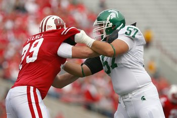MADISON, WI - SEPTEMBER 26: Jeff Stehle #79 of the Wisconsin Badgers moves off the line against Rocco Cironi #57 of the Michigan State Spartans on September 26, 2009 at Camp Randall Stadium in Madison, Wisconsin. (Photo by Jonathan Daniel/Getty Images)
