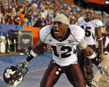 GAINESVILLE, FL - OCTOBER 16:  Defensive back Dennis Thames #12 of the Mississippi State Bulldogs celebrates a 10 - 7 victory against the Florida Gators October 16, 2010 Ben Hill Griffin Stadium at Gainesville, Florida.  (Photo by Al Messerschmidt/Getty I