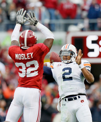 TUSCALOOSA, AL - NOVEMBER 26:  Quarterback Cam Newton #2 of the Auburn Tigers is pressured on the touchdown pass by C.J. Mosley #32 of the Alabama Crimson Tide at Bryant-Denny Stadium on November 26, 2010 in Tuscaloosa, Alabama.  (Photo by Kevin C. Cox/Ge