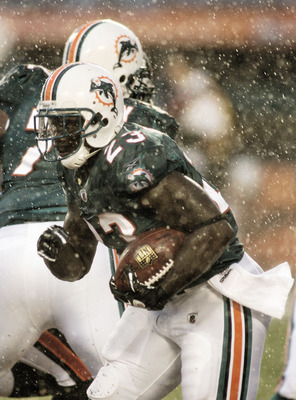 MIAMI - AUGUST 14:  Running back Ronnie Brown #23 rushes the ball in heavy rain against  the Tampa Bay Buccaneers during the preseason game at Sun Life Stadium on August 14, 2010 in Miami, Florida.  (Photo by Marc Serota/Getty Images)