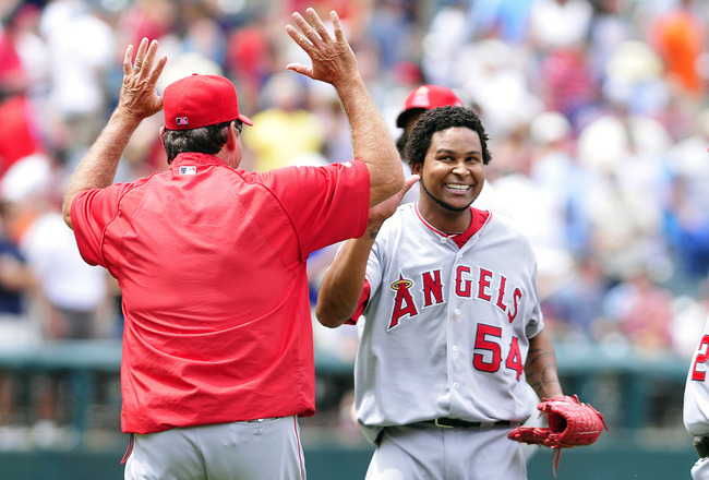 CLEVELAND, OH - JULY 27: Starting pitcher Ervin Santana #54 of the Los Angeles Angels celebrates with his teammates after throwing a no-hitter against the Cleveland Indians at Progressive Field on July 27, 2011 in Cleveland, Ohio. The Angels defeated the