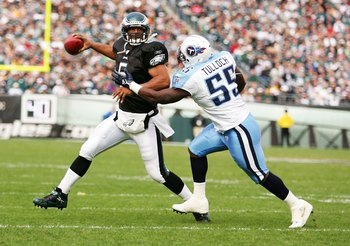 PHILADELPHIA - NOVEMBER 19:  Donovan McNabb #5 of the Philadelphia Eagles scrambles away from Stephen Tulloch #55 of  the Tennessee Titans on November 19, 2006 at Lincoln Financial Field in Philadelphia, Pennsylvania.  (Photo by Al Bello/Getty Images)