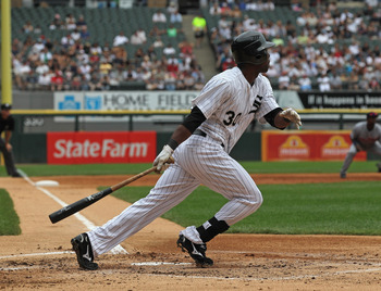 CHICAGO, IL - JULY 27: Alejandro De Aza #30 of the Chicago White Sox, in his first at-bat as a member of the team, hits his first Major League home run, a two-run shot in the 2nd inning, against  the Detroit Tigers at U.S. Cellular Field on July 27, 2011