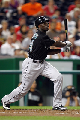 WASHINGTON, DC - JULY 27: Mike Cameron #24 of the Florida Marlins hits a homerun in the top of the eight against the Washington Nationals at Nationals Park on July 27, 2011 in Washington, DC. (Photo by Ned Dishman/Getty Images)