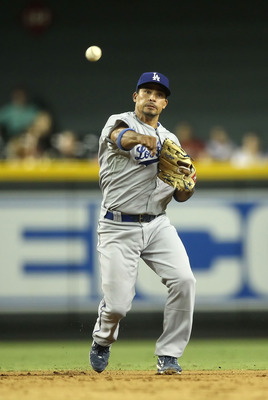 PHOENIX, AZ - JULY 15:  Infielder Rafael Furcal #15 of the Los Angeles Dodgers fields a ground ball out against the Arizona Diamondbacks during the Major League Baseball game at Chase Field on July 15, 2011 in Phoenix, Arizona. The Dodgers defeated the Di
