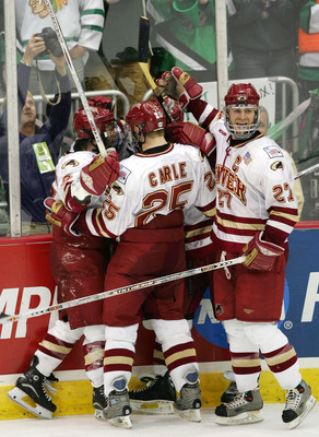 COLUMBUS, OH - APRIL 9:  Forward Gabe Gauthier #9 of the Denver Pioneers celebrates his empty net goal with teammates, defensemen Matt Carle #25 and Matt Laatsch #27, in the third period against the North Dakota Fighting Sioux during the NCAA Frozen Four