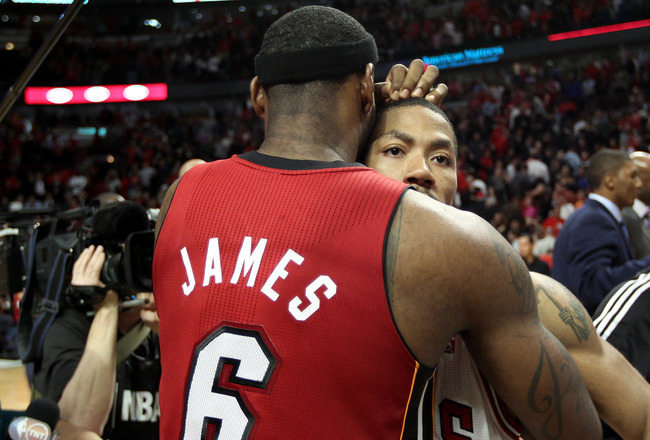 CHICAGO, IL - MAY 26:  Derrick Rose #1 of the Chicago Bulls looks on dejected as he congratulates LeBron James #6 of the Miami Heat after the Heat won 83-80 in Game Five of the Eastern Conference Finals during the 2011 NBA Playoffs on May 26, 2011 at the