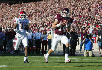 COLLEGE STATION, TX - NOVEMBER 6:  Wide receiver Chad Schroeder #14 of the Texas A&M University Aggies scores a touchdown near defensive back Eric Bassey #13 of the University of Oklahoma Sooners on November 6, 2004 at Kyle Field in College Station, Texas