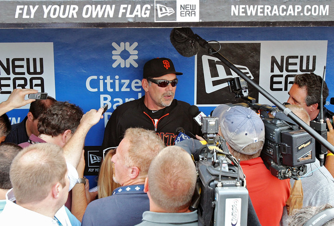 PHILADELPHIA , PA - JULY 27:  Manager Bruce Bochy #15 of the San Francisco Giants talks to the media prior to his game against the Philadelphia Phillies at Citizens Bank Park on July 27, 2011 in Philadelphia, Pennsylvania. The Giants defeated the Phillies