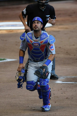 MILWAUKEE, WI - JULY 26: Geovany Soto #18 of the Chicago Cubs looks up as he runs to catch a foul ball against the Milwaukee Brewers at Miller Park on July 26, 2011 in Milwaukee, Wisconsin. (Photo by Scott Boehm/Getty Images)