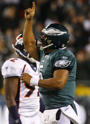 PHILADELPHIA - DECEMBER 27 : Donovan McNabb #5 of the Philadelphia Eagles celebrates after throwing a touchdown pass in the second quarter against the Denver Broncos at Lincoln Financial Field on December 27, 2009 in Philadelphia, Pennsylvania. (Photo by