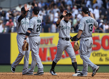 NEW YORK, NY - JULY 27: The Seattle Mariners celebrate the win against the New York Yankees on July 27, 2011 at Yankee Stadium in the Bronx borough of New York City.  (Photo by Nick Laham/Getty Images)