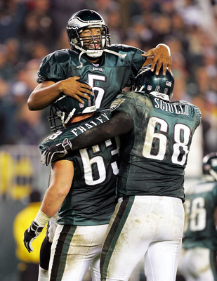 PHILADELPHIA - NOVEMBER 21:  Donovan McNabb #5 of the Philadelphia Eagles jumps into the arms of teammates Hank Fraley #63 and Steve Sciullo #68 after McNabb threw a touchdown pass to Brian Westbrook in the fourth quarter to give them a 28-6 lead over the