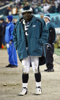 PHILADELPHIA - JANUARY 18:  Quarterback Donovan McNabb #5 of the Philadelphia Eagles watches from the sidelines after leaving the game with a rib injury in the forth quarter against Carolina Panthers during the NFC Championship game on January 18, 2004 at