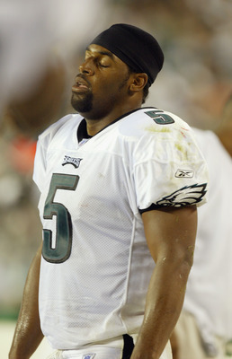 PHILADELPHIA - SEPTEMBER 14:  Donovan McNabb #5 of the Philadelphia Eagles dejected on the sideline after throwing an interception during the NFL game against the New England Patriots on September 14, 2003 at Lincoln Financial Field in Philadelphia, Penns