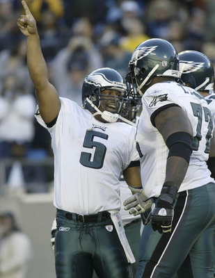 CHARLOTTE, NC- NOVEMBER 30:  Quarterback Donovan McNabb #5 of the Philadelphia Eagles celebrates a touchdown against the Carolina Panthers on November 30, 2003 at Ericcson Stadium in Charlotte, North Carolina.  (Photo By Streeter Lecka/Getty Images)