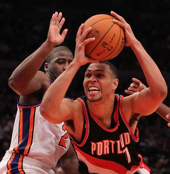NEW YORK - OCTOBER 30:  Brandon Roy #7 of the Portland Trail Blazer drives past Raymond Felton #2 of the New York Knicks at Madison Square Garden on October 30, 2010 in New York City. NOTE TO USER: User expressly acknowledges and agrees that, by downloadi