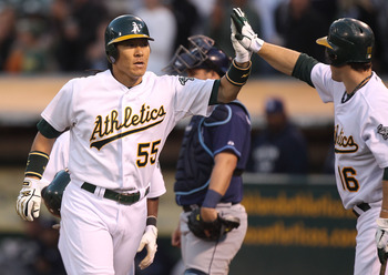 OAKLAND, CA - JULY 27:  Hideki Matsui #55 of the Oakland Athletics celebrates with Josh Willingham #16 after hitting a three run home run in the fourth inning against the Tampa Bay Rays at O.co Coliseum on July 27, 2011 in Oakland, California.  (Photo by