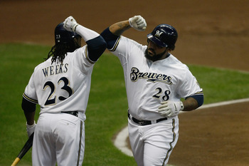 MILWAUKEE, WI - JULY 27: Prince Fielder #28 of the Milwaukee Brewers is congratulated by Rickie Weeks #23 after hitting a home run against the Chicago Cubs at Miller Park on July 27, 2011 in Milwaukee, Wisconsin. (Photo by Scott Boehm/Getty Images)