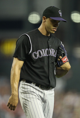 PHOENIX, AZ - JULY 24:  Starting pitcher Ubaldo Jimenez #38 of the Colorado Rockies during the Major League Baseball game against the Arizona Diamondbacks at Chase Field on July 24, 2011 in Phoenix, Arizona.  The Diamondbacks defeated the Rockies 7-0.  (P
