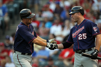ARLINGTON, TX - JULY 27:  Michael Cuddyer #5 of the Minnesota Twins celebrates a home run with Jim Thome #25 against the Texas Rangers at Rangers Ballpark in Arlington on July 27, 2011 in Arlington, Texas.  (Photo by Ronald Martinez/Getty Images)