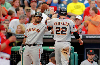 PHILADELPHIA , PA - JULY 27:  Eli Whiteside #22 and Pablo Sandoval #48 of the San Francisco Giants celebrate as Whiteside scores the first run of the game against the Philadelphia Phillies at Citizens Bank Park on July 27, 2011 in Philadelphia, Pennsylvan