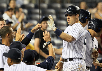 NEW YORK, NY - JULY 26: Mark Teixeira #25  of the New York Yankees celebrates his home run against the Seattle Mariners on July 26, 2011 at Yankee Stadium in the Bronx borough of New York City.  (Photo by Jim McIsaac/Getty Images)