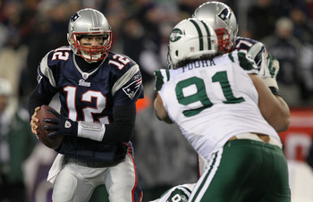 FOXBORO, MA - JANUARY 16:  Quarterback Tom Brady #12 of the New England Patriots looks to pass during their 2011 AFC divisional playoff game against the New York Jets at Gillette Stadium on January 16, 2011 in Foxboro, Massachusetts.  (Photo by Al Bello/G