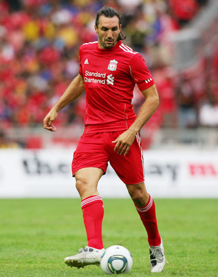 KUALA LUMPUR, MALAYSIA - JULY 16: Sotirios Kyrgiakos of Liverpool in action during the pre-season friendly match between Malaysia and Liverpool at the Bukit Jalil National Stadium on July 16, 2011 in Kuala Lumpur, Malaysia. (Photo by Stanley Chou/Getty Im