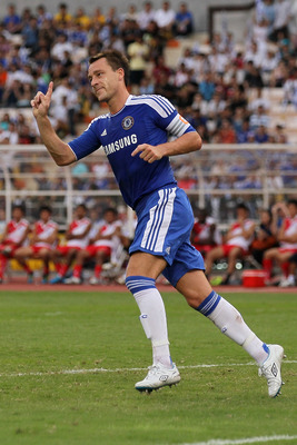 BANGKOK, THAILAND - JULY 24:  John Terry #26 of Chelsea reacts after being called off side during the pre-season friendly match between the Thailand All Stars and Chelsea at Rajamangala National Stadium on July 24, 2011 in Bangkok, Thailand.  (Photo by Ch