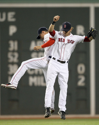 BOSTON, MA - JULY 27:  Jacoby Ellsbury #2 and Josh Reddick #16 of the Boston Red Sox celebrate the win over the Kansas City Royals on July 27, 2011 at Fenway Park in Boston, Massachusetts. The Boston Red Sox defeated the Kansas City Royals 12-5. (Photo by