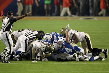 MIAMI GARDENS, FL - FEBRUARY 07:  The Indianapolis Colts fights for a loose ball against the New Orleans Saints after an onside kick to start the second half during Super Bowl XLIV on February 7, 2010 at Sun Life Stadium in Miami Gardens, Florida.  (Photo