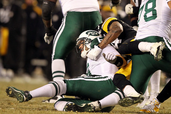 PITTSBURGH, PA - JANUARY 23:  Mark Sanchez #6 of the New York Jets gets hit by Ike Taylor #24 of the Pittsburgh Steelers during the 2011 AFC Championship game at Heinz Field on January 23, 2011 in Pittsburgh, Pennsylvania.  (Photo by Al Bello/Getty Images