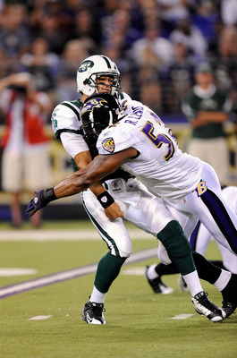 BALTIMORE - AUGUST 24:  Mark Sanchez #6 of the New York Jets is hit by Ray Lewis #52 of the Baltimore Ravens in a preseason game at M&T Bank Stadium on August 24, 2009 in Baltimore, Maryland.  Sanchez's pass was intercepted and returned for a touchdown on