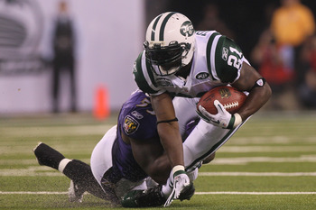 EAST RUTHERFORD, NJ - SEPTEMBER 13:  LaDainian Tomlinson #21 of the New York Jets  in action against the Baltimore Ravens during their home opener at the New Meadowlands Stadium on September 13, 2010 in East Rutherford, New Jersey.  (Photo by Jim McIsaac/