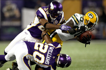 MINNEAPOLIS - NOVEMBER 21: Donald Driver #80 of the Green Bay Packers is brought down by Antonio Winfield #26 and Madieu Williams #20 of the Minnesota Vikings at the Hubert H. Humphrey Metrodome on November 21, 2010 in Minneapolis, Minnesota.  (Photo by M