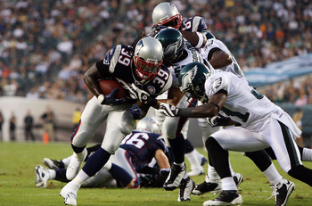 PHILADELPHIA - AUGUST 13:  Laurence Maroney #39 of the New England Patriots runs the ball for a first down against the Philadelphia Eagles on August 13, 2009 at Lincoln Financial Field in Philadelphia, Pennsylvania.  (Photo by Jim McIsaac/Getty Images)