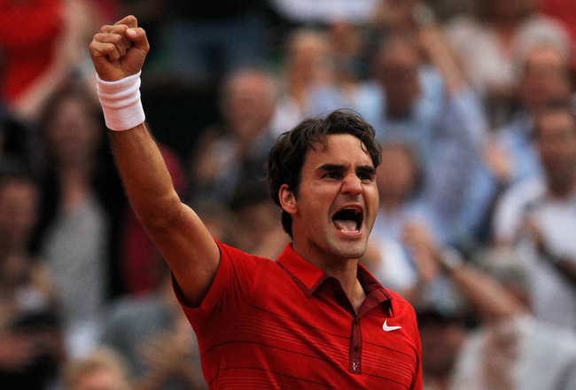 PARIS, FRANCE - JUNE 03:  Roger Federer of Switzerland celebrates match point during the men's singles semi final match between Roger Federer of Switzerland and Novak Djokovic of Serbia on day thirteen of the French Open at Roland Garros on June 3, 2011 i