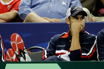 AUSTIN, TX - JULY 10:  Andy Roddick watches as David Ferrer of Spain plays Mardy Fish during the fourth rubber of the Davis Cup tie between USA and Spain at the Frank Erwin Center on July 10, 2011 in Austin, Texas.  (Photo by Matthew Stockman/Getty Images