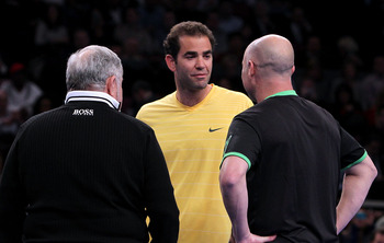 NEW YORK, NY - FEBRUARY 28:  Pete Sampras (C) talks on court with Andre Agassi (R) during the BNP Paribas Showdown at Madison Square Garden on February 28, 2011 in New York City.  (Photo by Nick Laham/Getty Images)