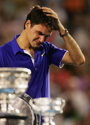 MELBOURNE, AUSTRALIA - FEBRUARY 01:  Roger Federer of Switzerland shows his emotion during the trophy presentation after his men's final match against Rafael Nadal of Spain during day fourteen of the 2009 Australian Open at Melbourne Park on  February 1,