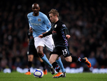 MANCHESTER, UNITED KINGDOM - MARCH 02:   Barry Bannan of Aston Villa competes with Patrick Vieira of Manchester City during the FA Cup sponsored by E.On Fifth Round match between Manchester City and Aston Villa at the City of Manchester Stadium on March 2