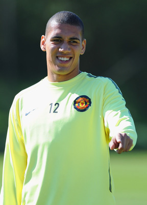 MANCHESTER, ENGLAND - MAY 03: Chris Smalling looks on during a training session ahead of their UEFA Champions League semi final second leg match against Schalke 04 at the Carrington Training Ground on May 3, 2011 in Manchester, England.  (Photo by Michael