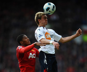 MANCHESTER, ENGLAND - MARCH 19: Antonio Valencia of Manchester United battles with Stuart Holden of Bolton Wanderers during the Barclays Premier League match between Manchester United and Bolton Wanderers at Old Trafford on March 19, 2011 in Manchester, E