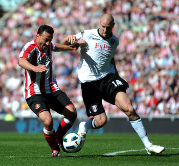 SUNDERLAND, ENGLAND - APRIL 30:  Steed Malbranque (L) of Sunderland competes with Philippe Senderos of Fulham during the Barclays Premier League match between Sunderland and Fulham at Stadium of Light on April 30, 2011 in Sunderland, England.  (Photo by C