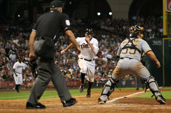 HOUSTON,TX- JULY 16: Hunter Pence #9 of the Houston Astros scores at home plate on a Humberto Quintero game winning RBI in the 8th inning against  the Pittsburgh Pirates on July 16, 2011 at Minute Maid Park in Houston, Texas. Astros won 6 to 4. (Photo by