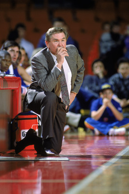 1990:  Head Coach Bill Fitch of the New Jersey Nets kneels on the sideline during an NBA game in 1990. NOTE TO USER: User expressly acknowledges and agrees that, by downloading and/or using this Photograph, User is consenting to the terms and conditions o