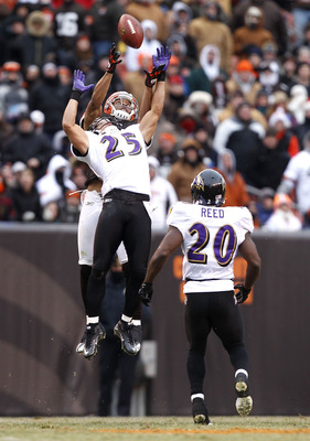 CLEVELAND - DECEMBER 26:  Safety Chris Carr #25 of the Baltimore Ravens jumps for the ball as safety Ed Reed #20 looks on with wide receiver Chansi Stuckey #83 of the Cleveland Browns at Cleveland Browns Stadium on December 26, 2010 in Cleveland, Ohio.  (